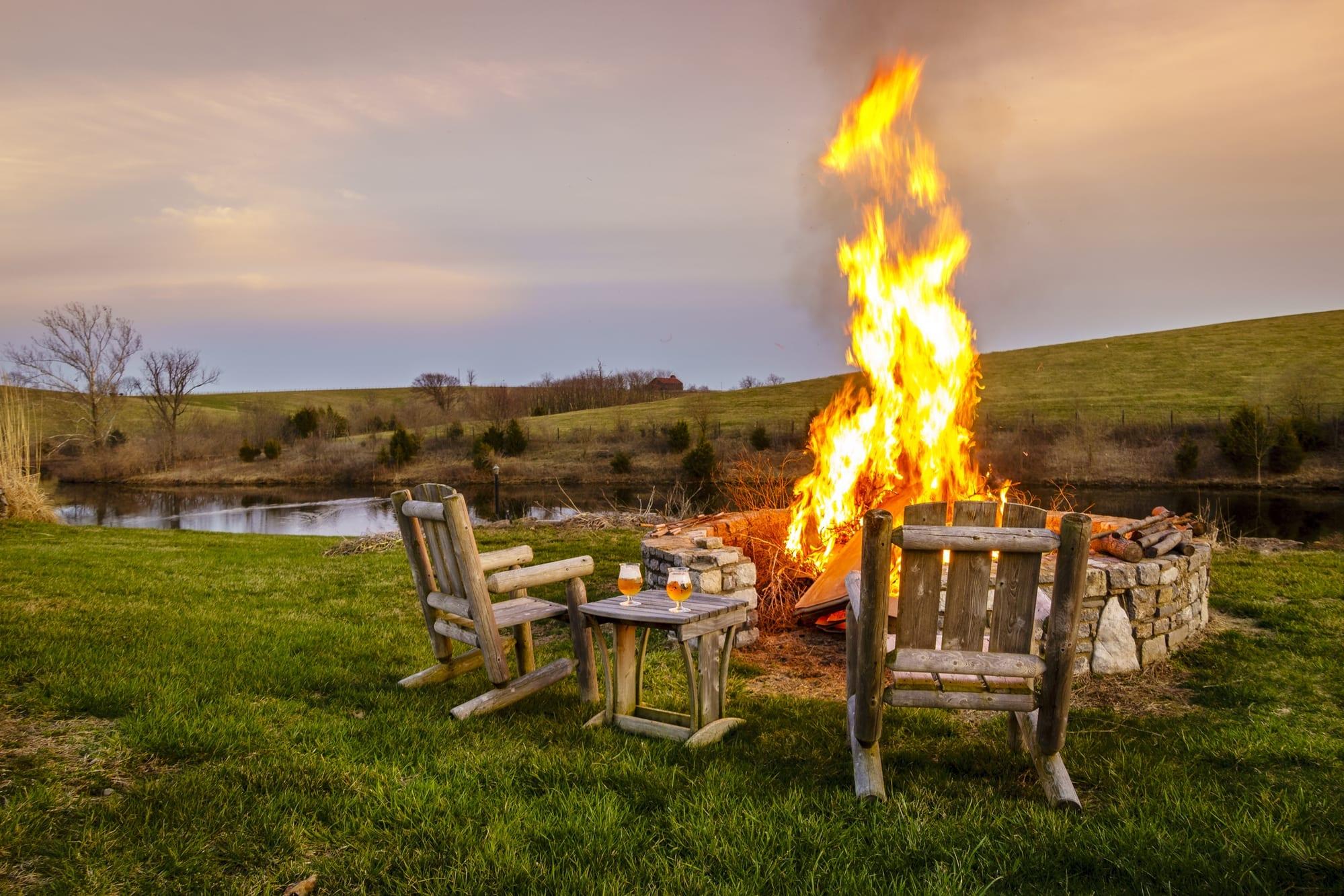 A big bonfire burns outside
