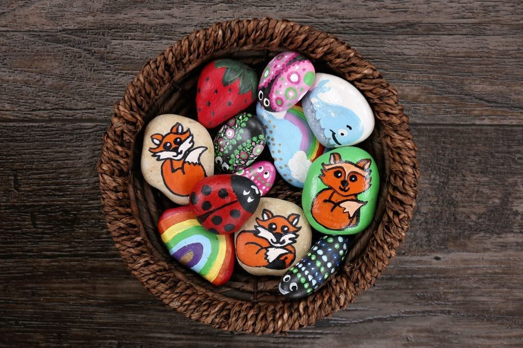 A basket of painted garden pebbles