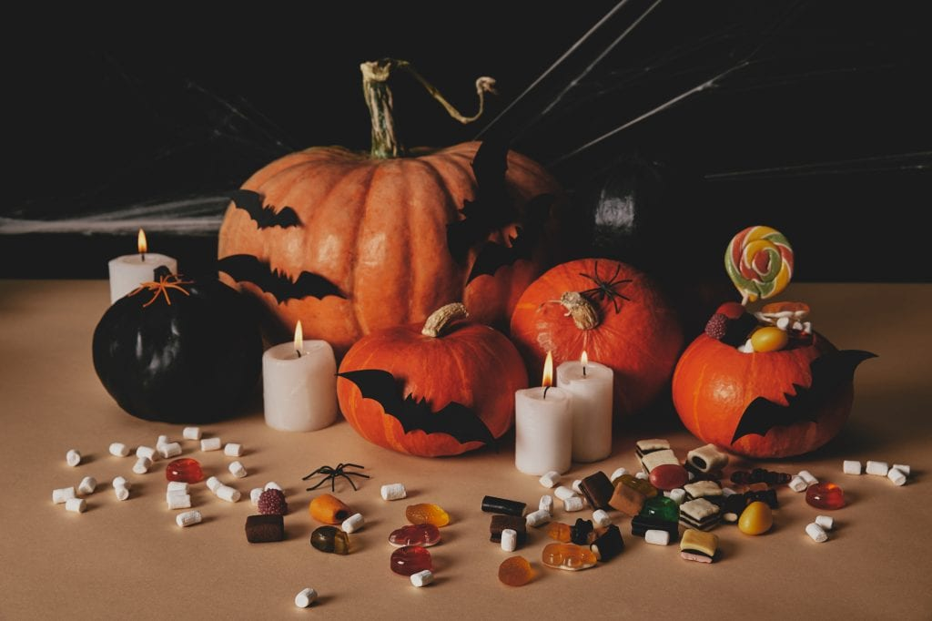 Pumpkins with candles, bats and candy